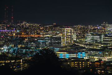 Colorful Cityscape Lights Background of Seattle Buildings Illuminated from Viewpoint.