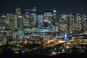 Illuminated Modern City Building Lights Background of Seattle Skyline.