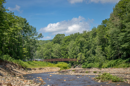 river in stowe vermont with vermont bridge in background