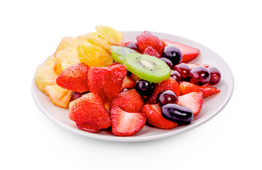 fresh fruits on plate isolated on white background Wall mural