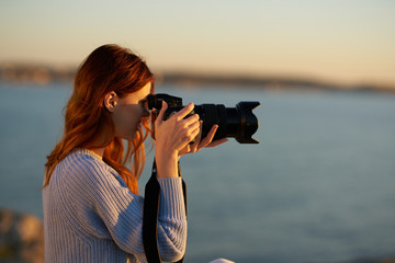 woman with camera sunset nature