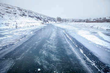 Thin ice layer of frozen river