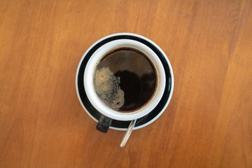 Hot black coffee on the table