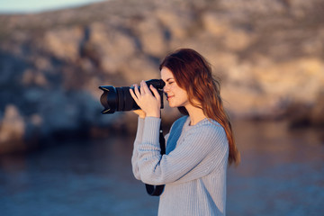woman takes pictures of nature