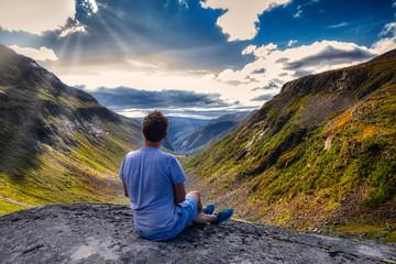 Man hiking in the mountains in Kleadalen, Aurland, Flaam - in Norway