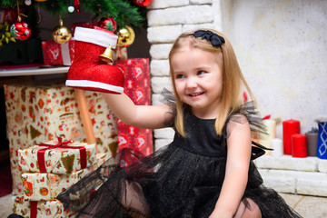 Concept portrait of a cute beautiful girl child in the new year with a gift