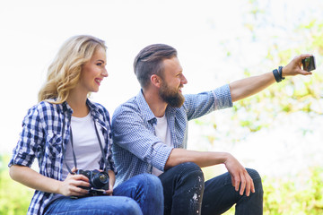 Young loving couple making selfie photo outdoor.
