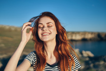 woman smiling with eyes closed nature