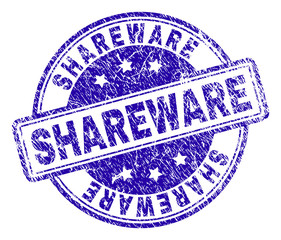 SHAREWARE stamp seal watermark with distress texture. Designed with rounded rectangles and circles. Blue vector rubber print of SHAREWARE text with unclean texture.