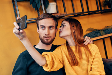 selfie on smartphone young couple in cafe