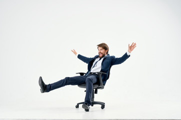business man riding his chair on an isolated background
