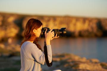 photographer takes on camera nature sunset