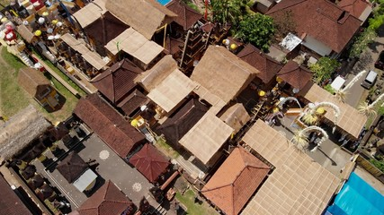 aerial photo of balinese houses during the big celebration. Bali ceremony in village, Ubud. Roofs of balinese houses.