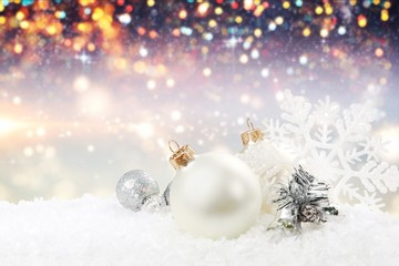Silver shiny christmas balls in snow isolated on white