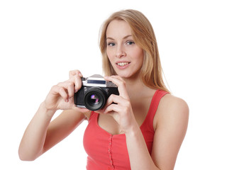 young woman taking picture with analog 35mm camera