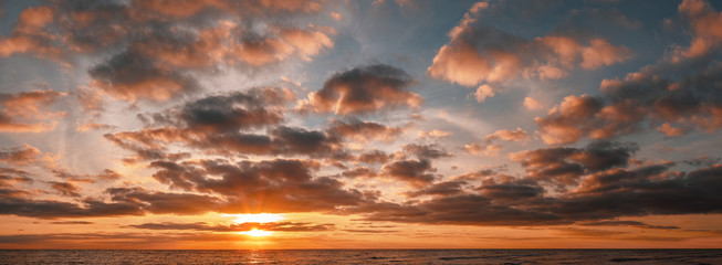Panoramic shot of beautiful sunrise over the ocean with copy space