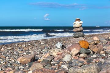 Day of Harmony at Natural Stony Coast / Heap of stones in balance at stony beach of baltic sea (copy space)