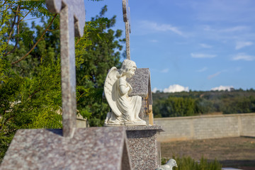 Angel statue, wing on the tombstone, graveyard local cemetery