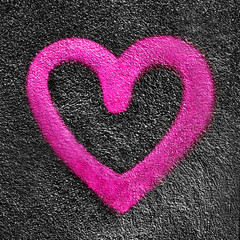 Pink heart on asphalt background