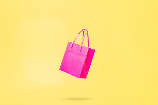 Flying Shop Bag Store Sale Concept Pink and Yellow Color