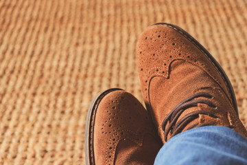 Top view from man with brown leather shoes and jeans