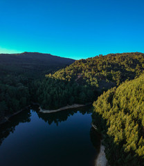 Aerial view of a dam surrounded by a forest. Sintra Portugal