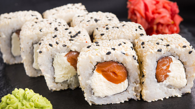 Sushi roll with wasabi and ginger