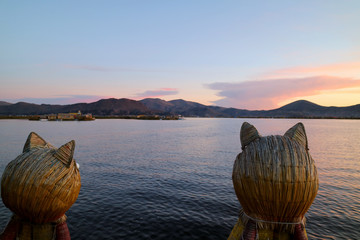 Foto op Canvas Zuid-Amerika land Stunning View of Lake Titicaca after Sunset as Seen from the Famous Totora Reed Boat with a Pair of Puma Shaped Prows, Puno, Peru