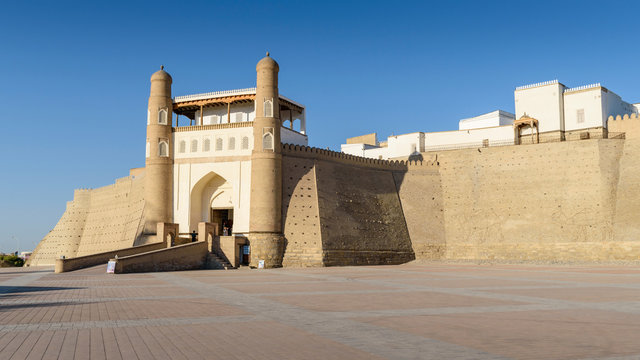 Exterior view of the 5th century Ark Citadel in Bukhara, a UNESCO world heritage site, large earthen fortification.