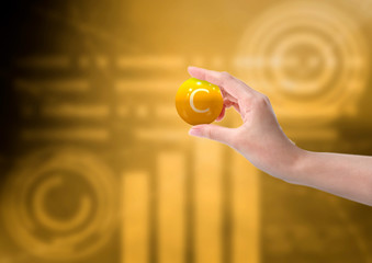 woman hand holding vitamin c capsule, orange color, on background with graph. 3D rendering