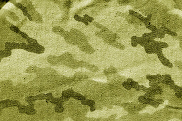 Dirty camouflage cloth in yellow tone.