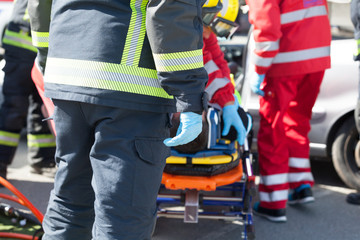Paramedics and firefighters in a rescue operation after road traffic accident