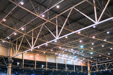 Interior of warehouse. large metal structures, ceiling. roof. concept production and installation of equipment for rooms, lighting, ventilation and windows for hangars