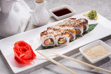 Tasty japan sushi with red ginger, soy sauce and sesame