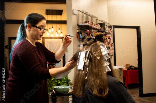 Professional Millennial Hair Stylist Applying Hair Color