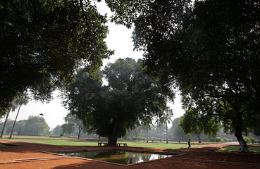An Indian walk in the gardens of Humayun's Tomb in New Delhi.