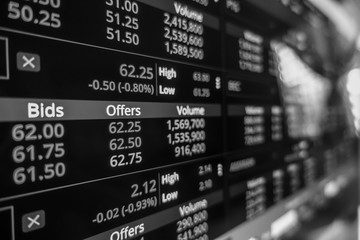 Stock exchange market in black and white on LED screen. Finance and economic concept.