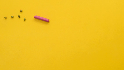 Wall Mural - crayon symbol on yellow background