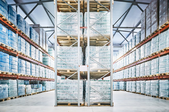 Hangar warehouse with rows of shelves with transparent plastic bags
