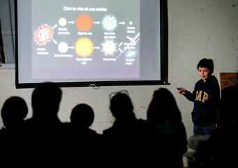 Ricardo Barriga, 10, speaks and teaches astronomy to adults and younger in hopes of raising money for his own astronaut suit, in Pirque