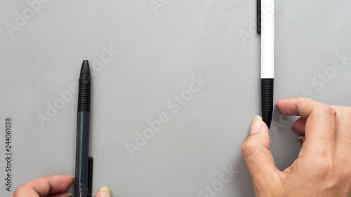 Wall mural pen with hand on gray background business concept