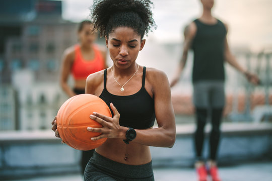 Portrait of athlete woman holding basketball
