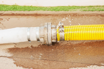 yellow water pipe with the water leakage.