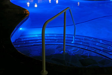Steps into swimming pool by night