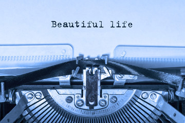 Beautiful life printed on a piece of paper on a vintage typewriter. writer, journalist.