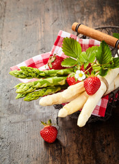 Fresh bunches of green and white asparagus tips
