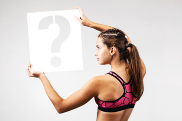 fit girl holding question mark