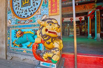 Colorful royal guardian lion of Long Shan Tang Clan Temple, Yangon, Myanmar