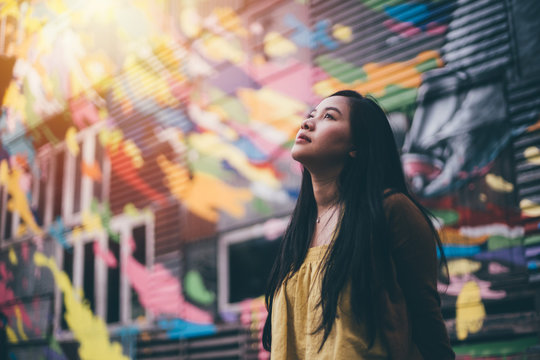 Young pretty hipster asian woman