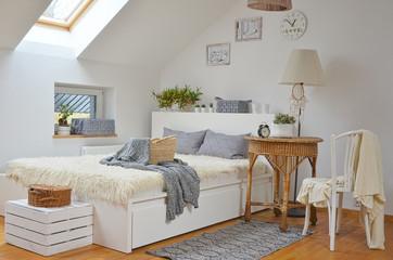 White scandinavian bedroom in the attic
